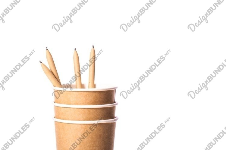 stack of paper cups with pen made of recycled paper example image 1