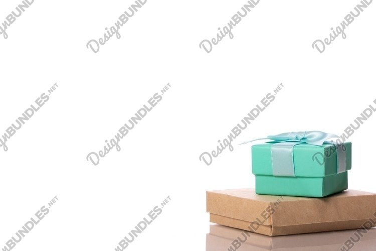 Light green square cardboard gift box tied with satin ribbon example image 1