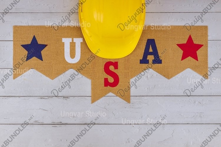 Construction yellow helmet on happy Labor Day US patriotic example image 1