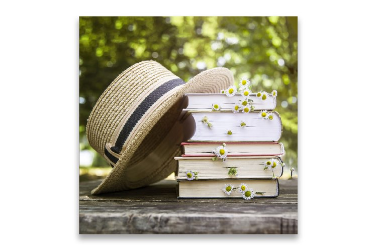 Books in rustic style with hat and flowers. example image 1