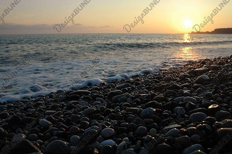 Sea surf at sunset