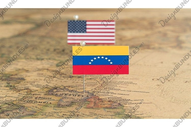 Flags of the USA and Venezuela on the world map. Politics example image 1