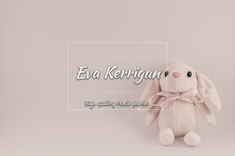 Postcard with sitting toy pink rabbit on a white background. example image 1