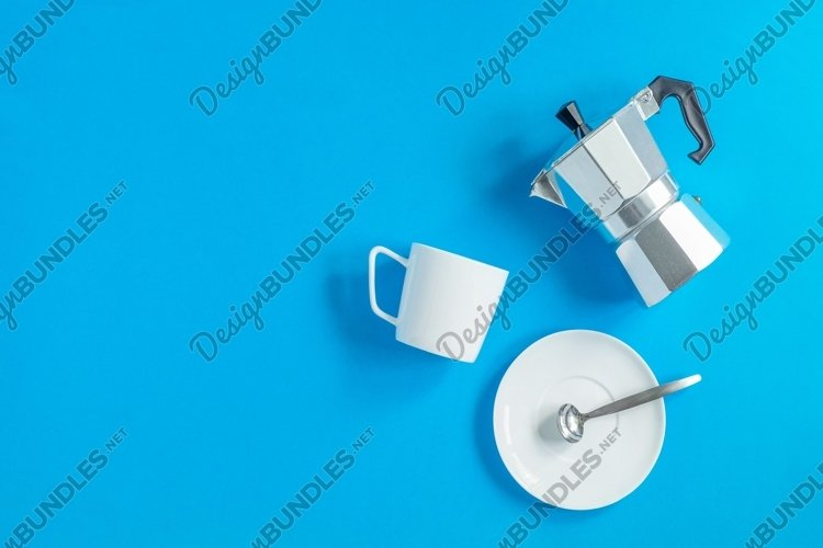 Italian geyser coffee maker and cup and saucer example image 1