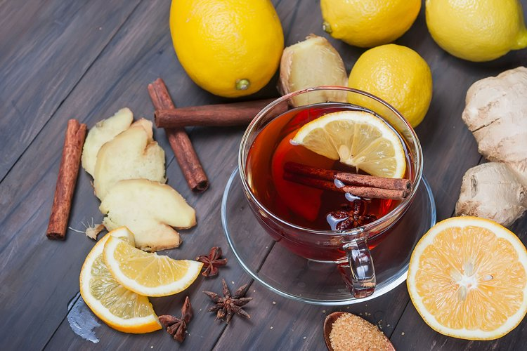 Cup of Ginger tea with lemon and honey on dark brown wooden example image 1