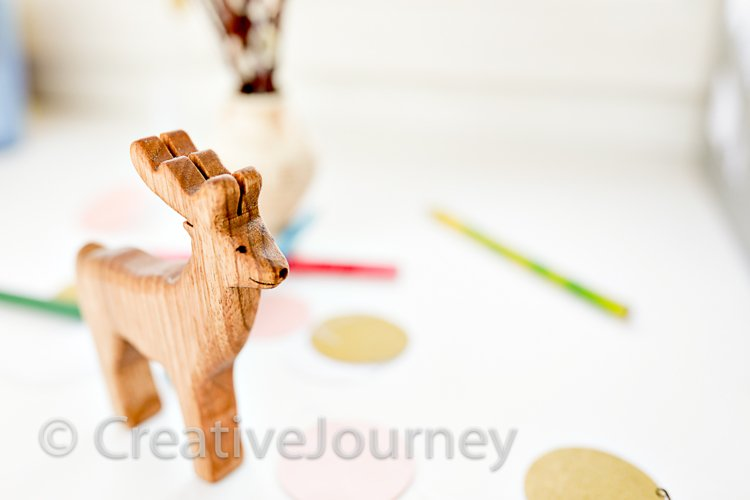 Wooden deer and pencils.