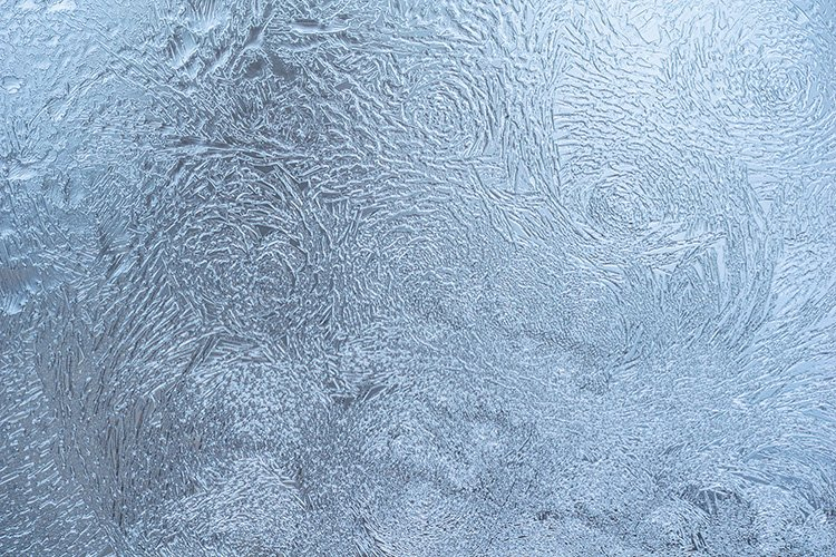 Stock Photo - Frosty natural pattern on winter window example image 1