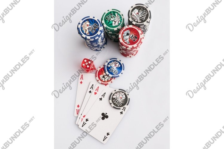 Poker chips, cards and dice on a white. Casino and poker example image 1