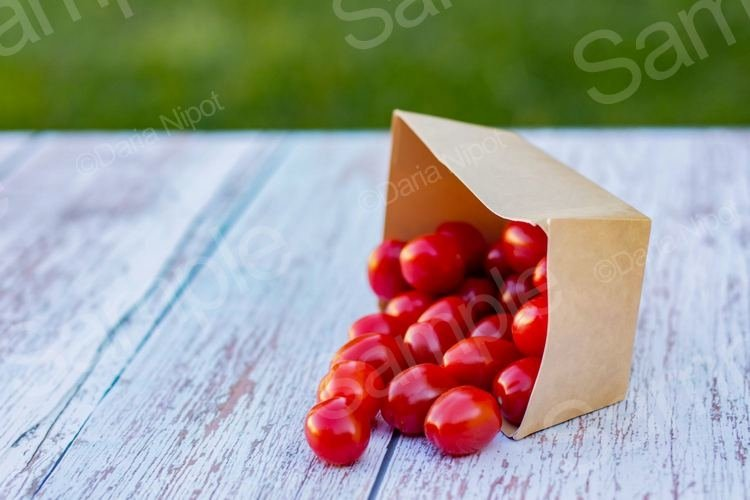 Cherry tomatoes in a recycleable paper box