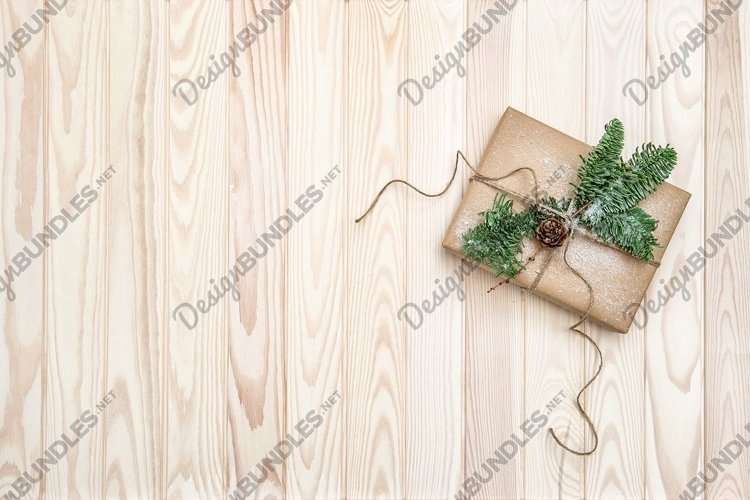 Christmas decoration wrapped gift pine tree branches example image 1