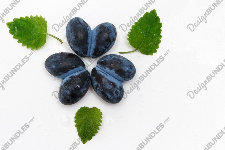 Photo of plum in the shape of a heart