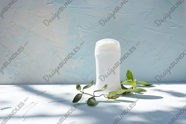 Stick deodorant and branch of tree at concrete textured wall example image 1