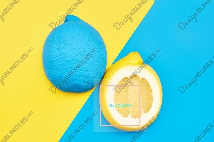 Cut in half lemon colored. yellow blue background. design example image 1