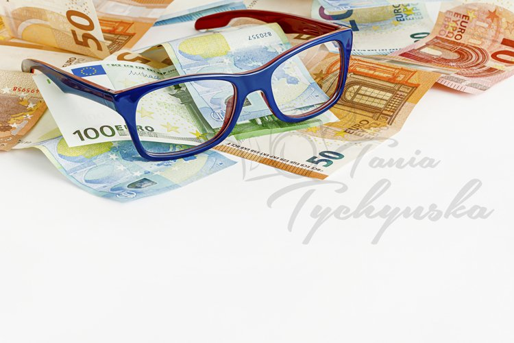Glasses and euro currency. Finance concept.