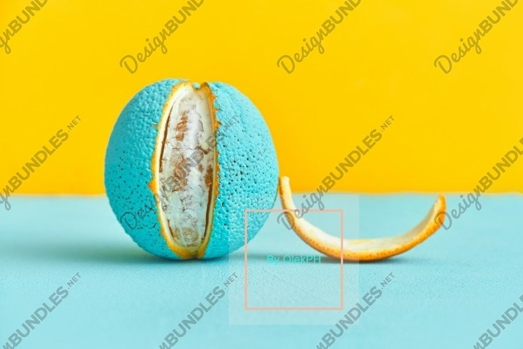 Peeled lobule peel of an orange painted in turquoise color. example image 1