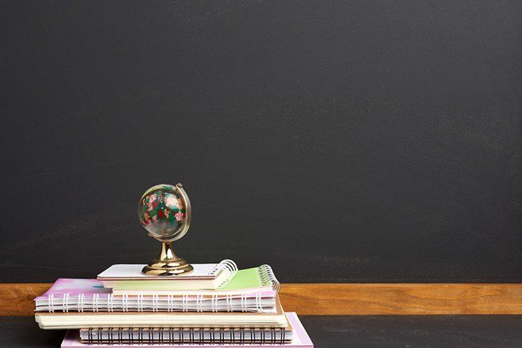 stack of paper school notebooks and glass globe example image 1