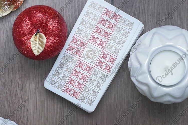 Tarot card reader arranges cards in a card spread.