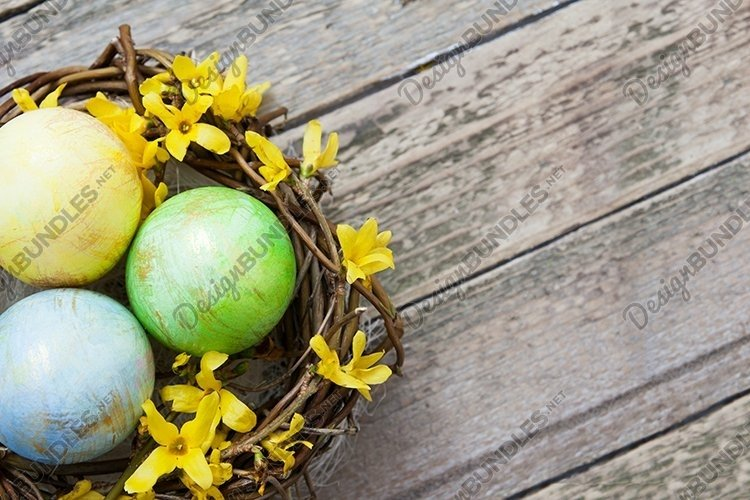 Nest with eggs and flowers on Wooden background example image 1