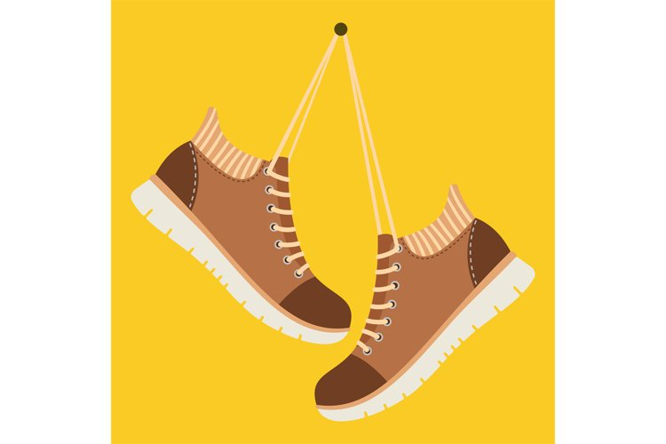 Brown shoes hang on laces example image 1