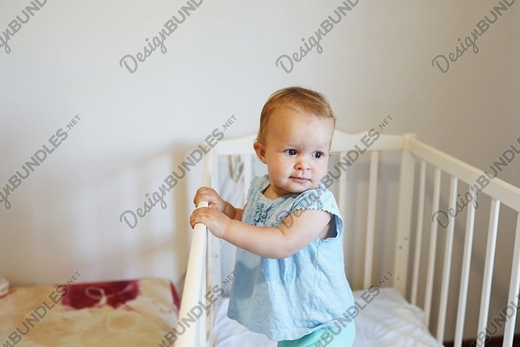 funny toddler baby girl standing in her white bed example image 1