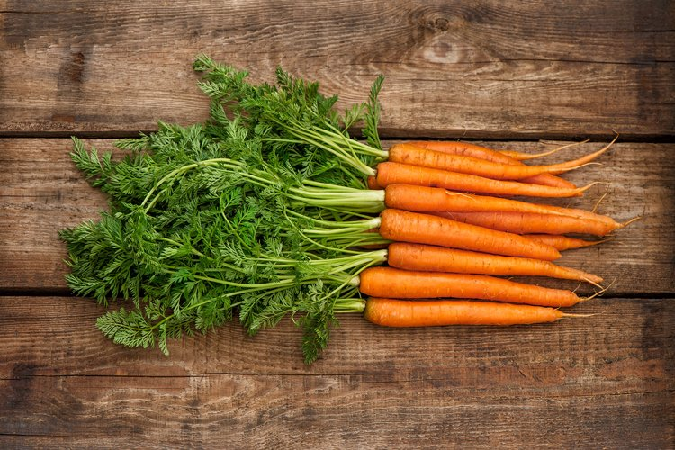 Carrots with green leaves wooden background Food Vegetable example image 1
