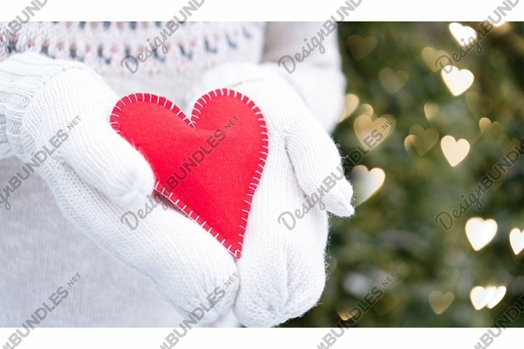 Red heart in hands. Love declaration and donation concept