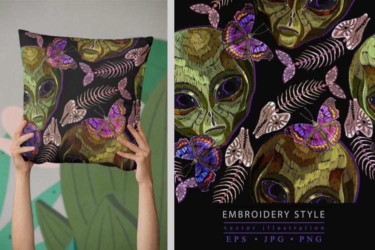 Alien head, butterflies and fish bone