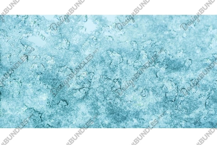 Frozen water. Snowflakes sparkling in the sun example image 1