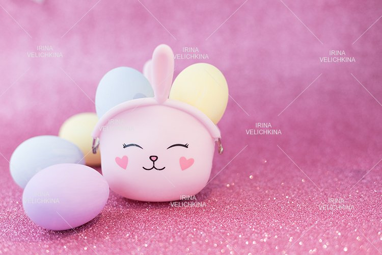 Easter bunny bag with ears.Multicolored eggs.Pink background