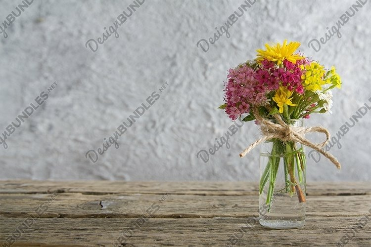 Miniature glass bottle with wildflowers copy space example image 1