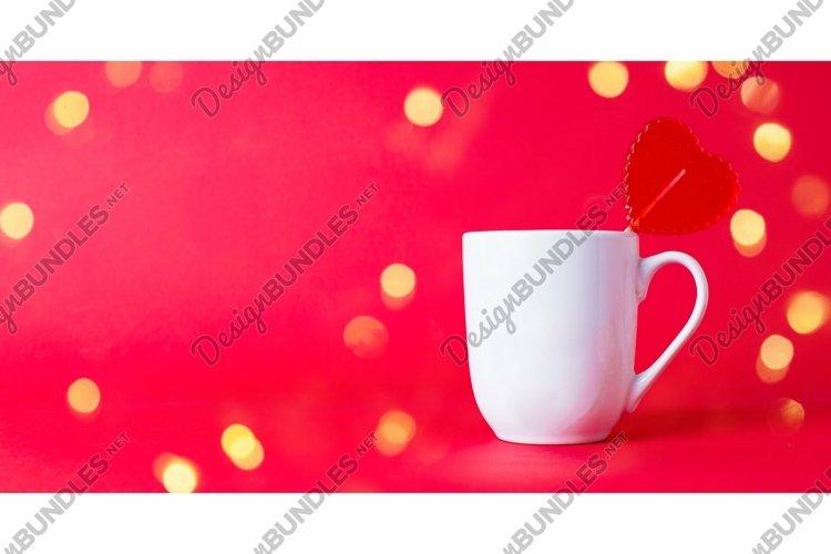 Red sweet heart shaped Lollipop in white mug