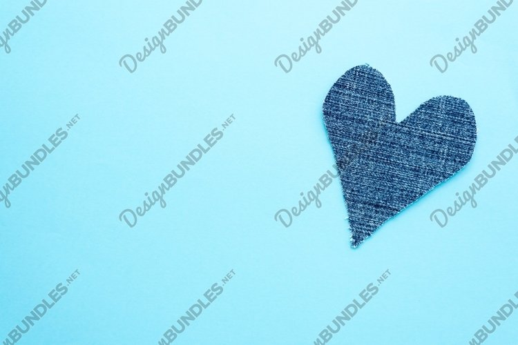 Denim heart on blue background. Mockup for greeting card example image 1