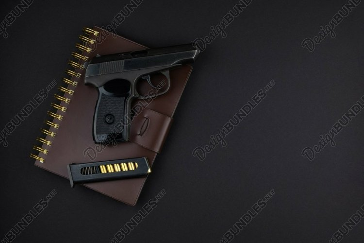 the gun and the loaded magazine