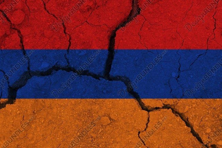Armenia flag on the cracked earth. National flag of Armenia.