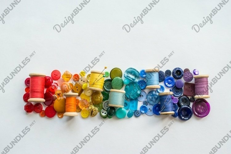 Buttons, threads rainbow color. White background. Copy space example image 1