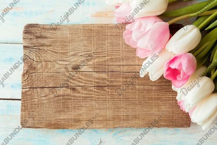 Aerial pink tulips on rustic wooden background example image 1