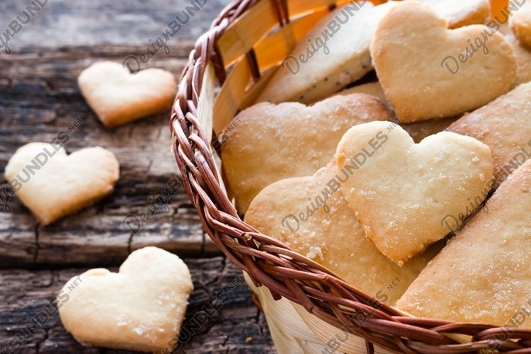homemade cookies in the shape of a heart in a basket