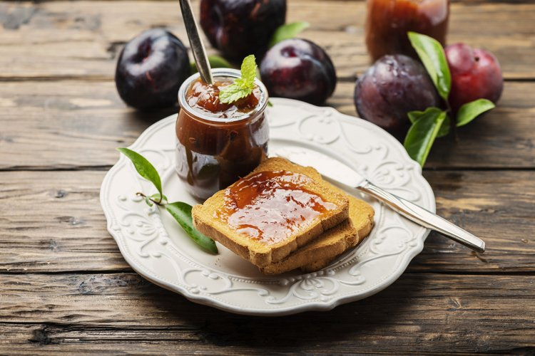 Breakfast with toast and plum jam example image 1