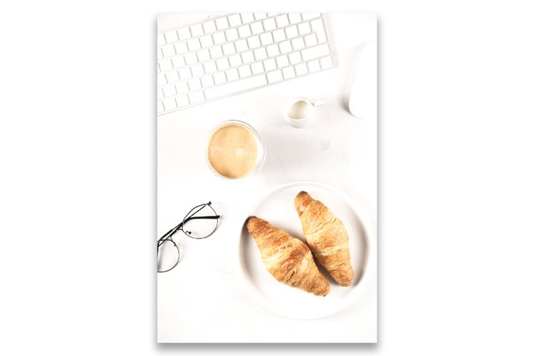 Croissants in a bright workplace as a snack during work