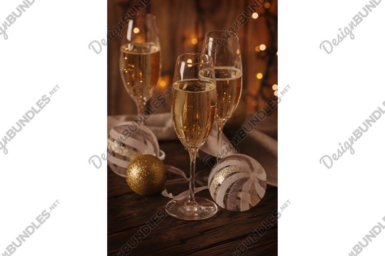 Glasses of champagne on the christmas background example image 1