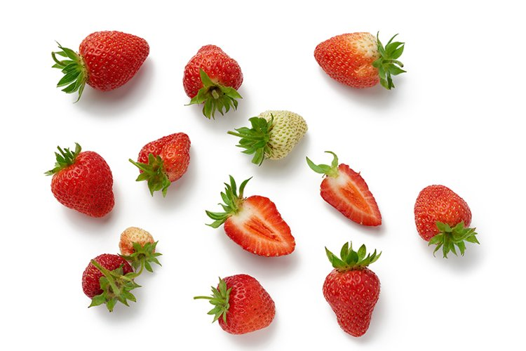 whole and halves of fresh ripe red strawberries example image 1