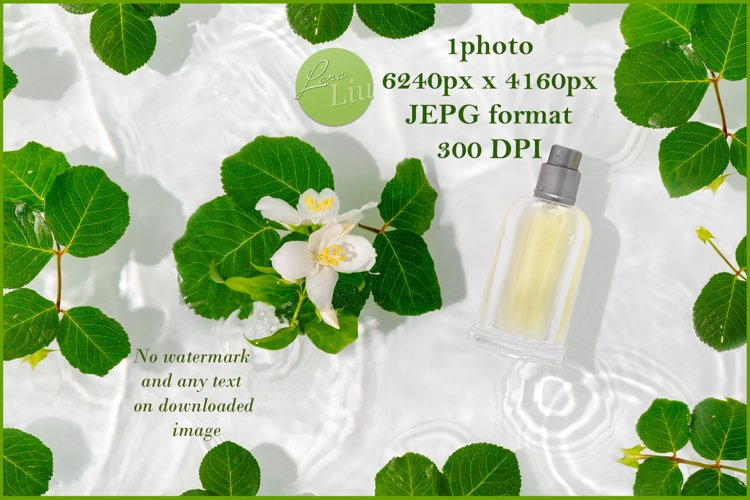 A bottle of perfume in pure waves of water with jasmine example image 1