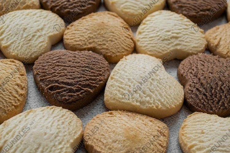 Heart-shaped cookies background. Copy space