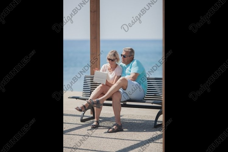 Parents have rest at the sea example image 1