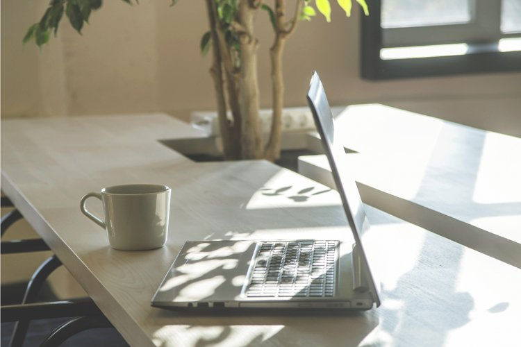 Modern workplace with laptop in the shadows. example image 1