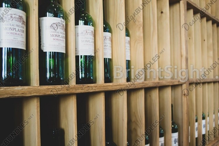Wine bottles on wooden shelves example image 1