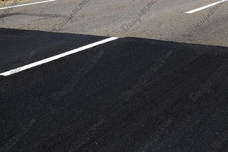 repaired part of the paved road example image 1