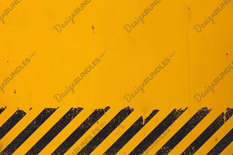 Yellow Background with Black Grunge Hazard Sign