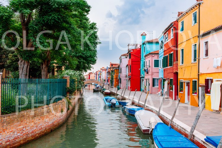 Traditional vibrant colored houses along chanal in Burano example image 1