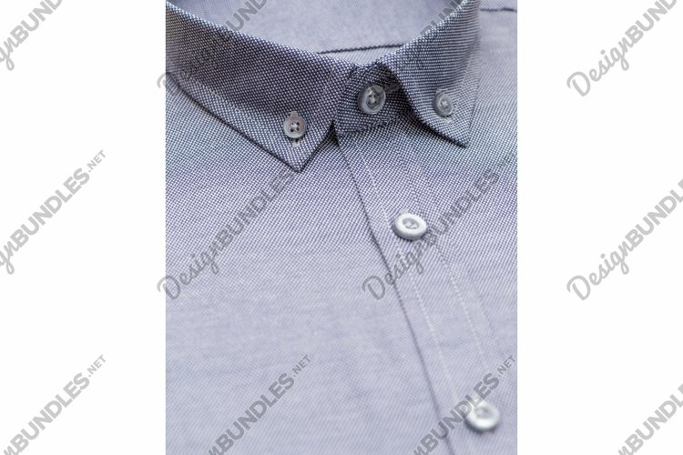 Blue shirt with a focus on the collar and button, close-up example image 1